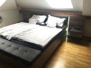 Schlafzimmerschrank (Schwebetür), Bett