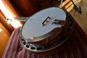 Banjospieler-Gitarrist sucht