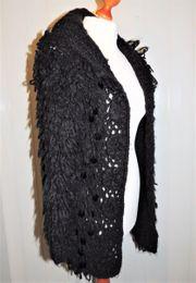 Kuschelige Grob-Strickjacke schwarz mit Pailletten