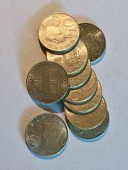 Kaufe zehn Schilling Silber Münzen